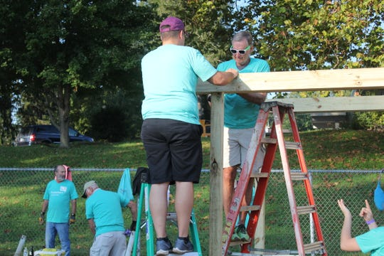 Volunteers work to build a KaBOOM! playground at Black Mountain Primary on Oct. 6.