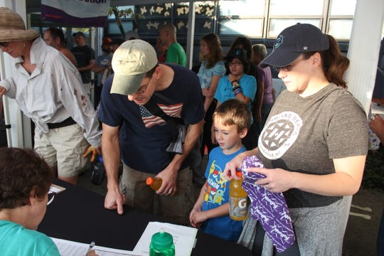 Volunteers sign in at Black Mountain Primary School on Oct. 6, as a KaBOOM! playground is constructed by the community.