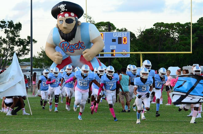 The home team Raiders make their entrance Friday night.