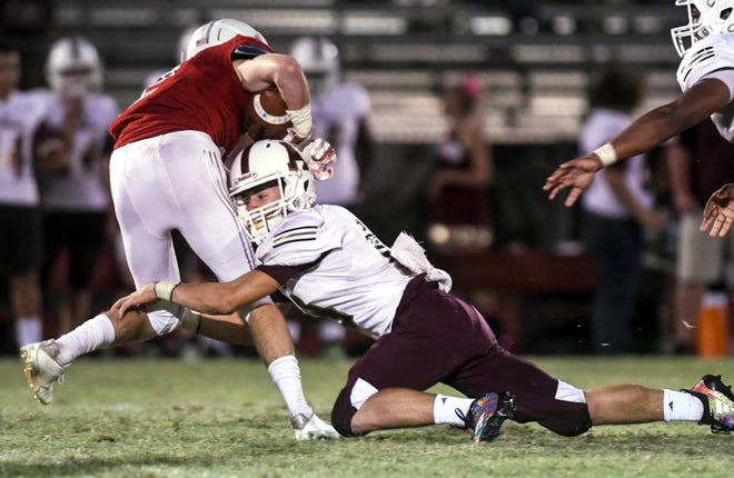 Astronaut's Hunter Galloway makes a tackle during Friday's game.