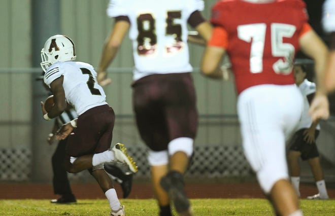 Jaiden Dollard of Astronaut (2) takes a Satellite interception to the end zone during Friday's game.