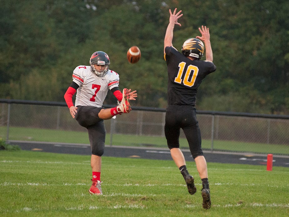 Colonel Crawford's Andrew Geiger attempts to block a punt by Buckeye Central's Brady Kerschner.