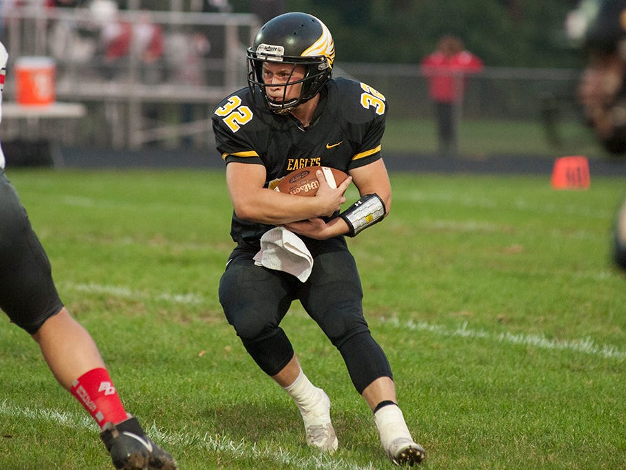 Colonel Crawford's Dylan Knisely rushes the ball.