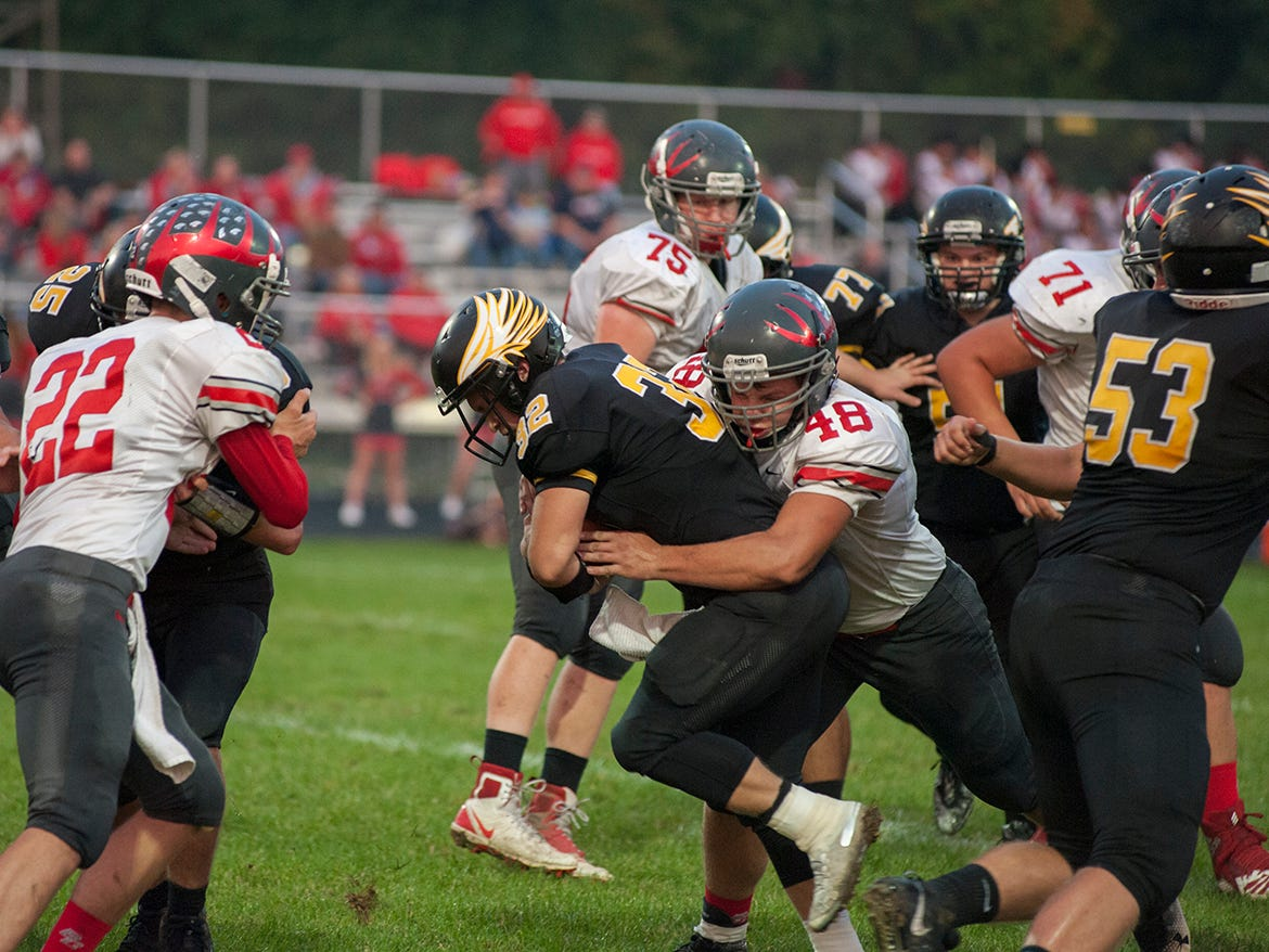 Buckeye Central's Jacob Maxhimer tackles Colonel Crawford's Dylan Knisely.