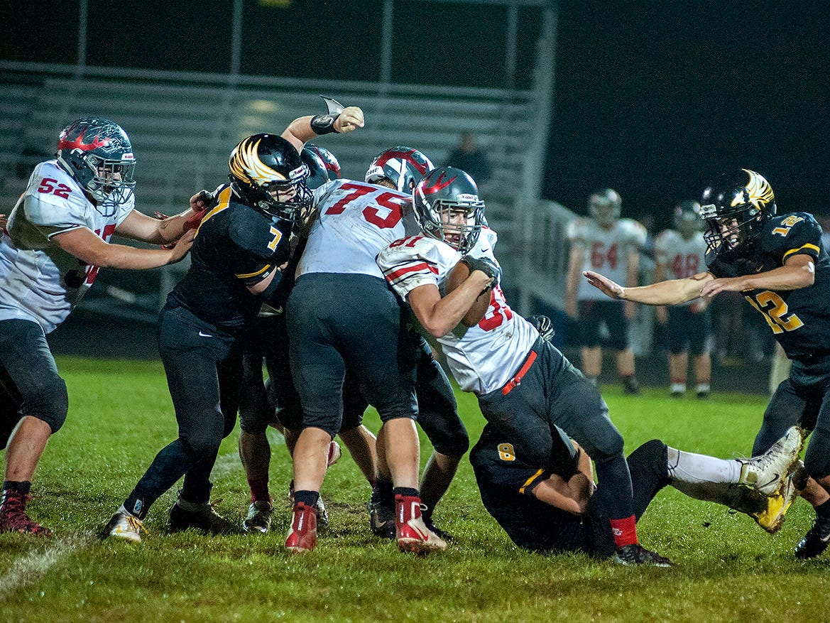 Buckeye Central's Jacob Heefner gets hung up by the Colonel Crawford defense.