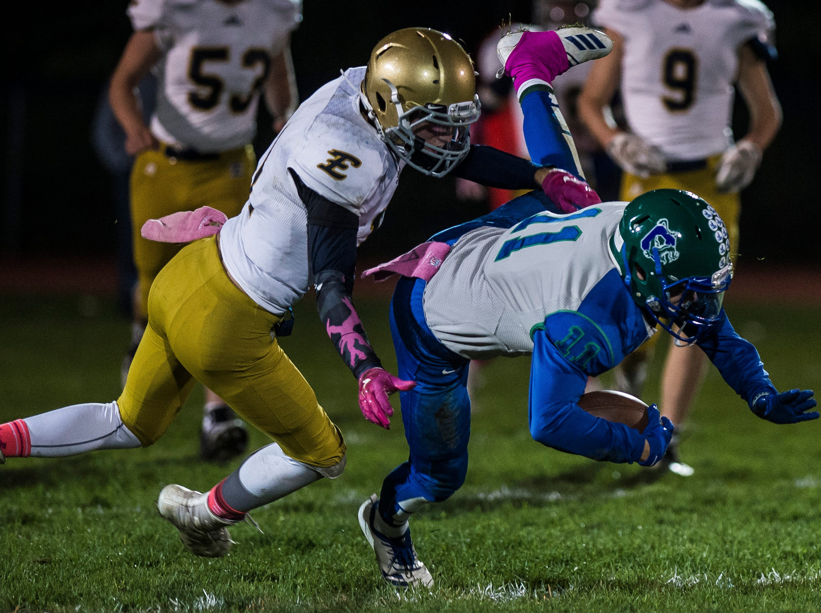 Colchester #11 Bailey Olson is chased down by Essex #11 Chris Labonte during their football game against Essex Friday night, Oct. 5, 2018, at Colchester High School. The Lakers won, 28-7.