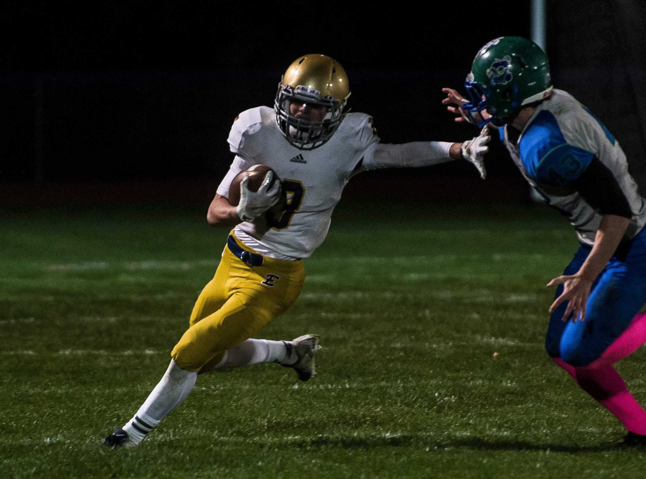 Essex #3 Tyler Millette runs past Colchester #43 Max Anderson during their football game Friday night, Oct. 5, 2018, at Colchester High School. The Lakers won, 28-7.