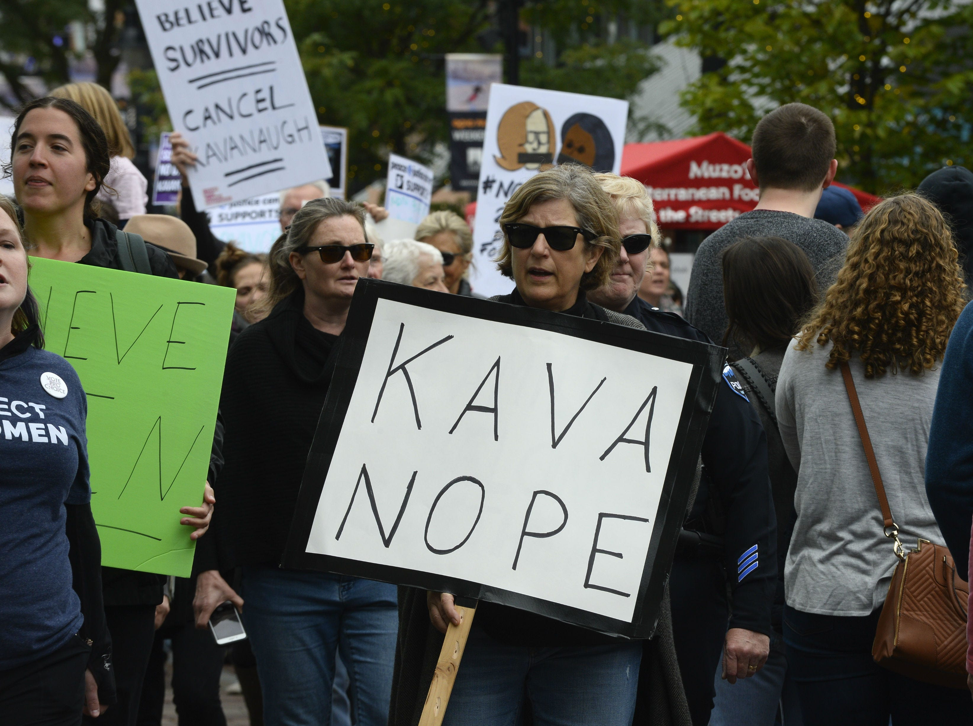 Protesters marched through downtown Burlington Saturday, Oct. 6, 2018, against the confirmation of Supreme Court Justice Brett Kavanaugh. About 100 people turned out for the march down Church Street and around City Hall Park.