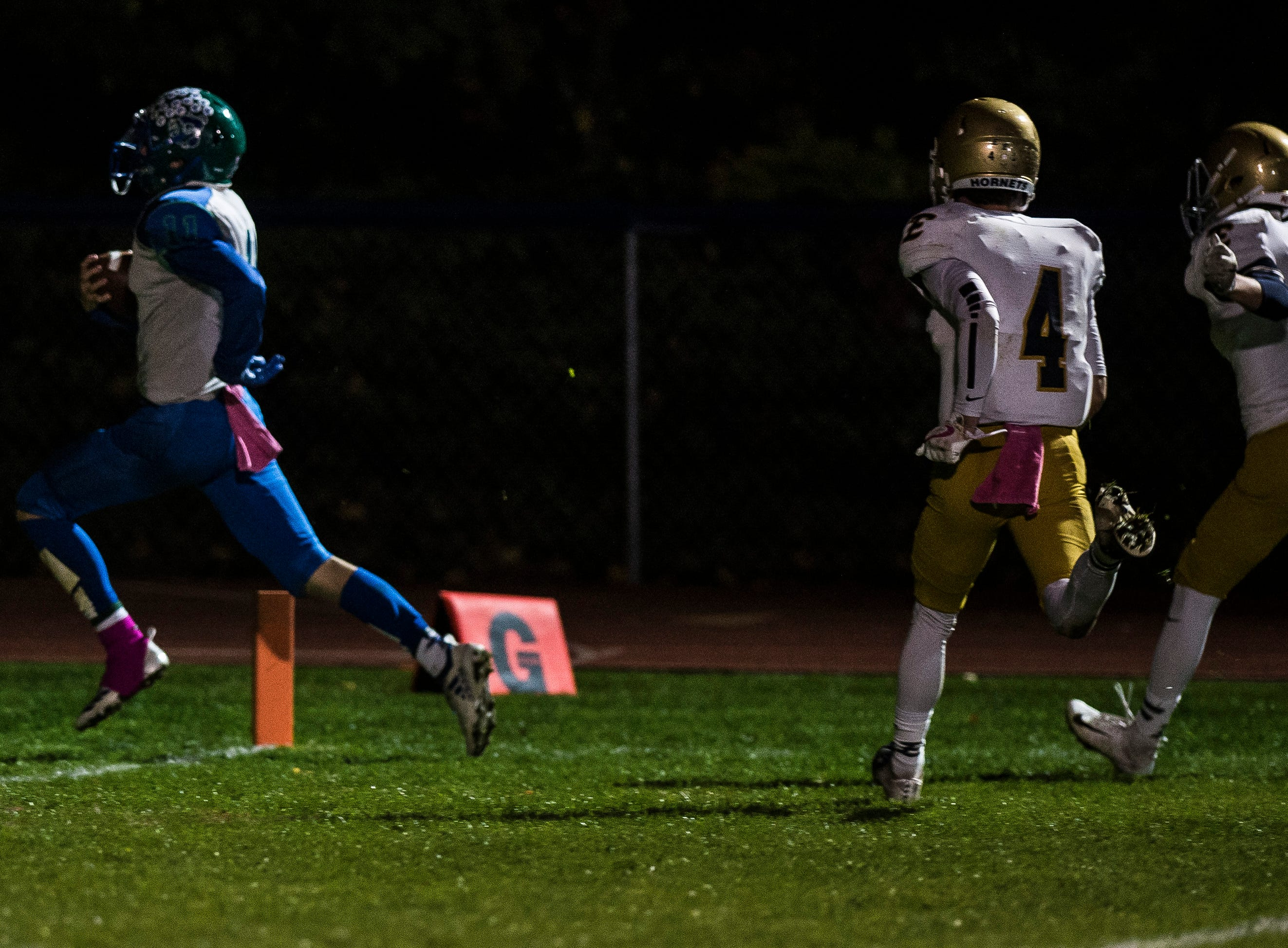 Colchester #11 Bailey Olson sails into the end zone for the touchdown after a long-distance run during their football game against Essex Friday night, Oct. 5, 2018, at Colchester High School. The Lakers won, 28-7.