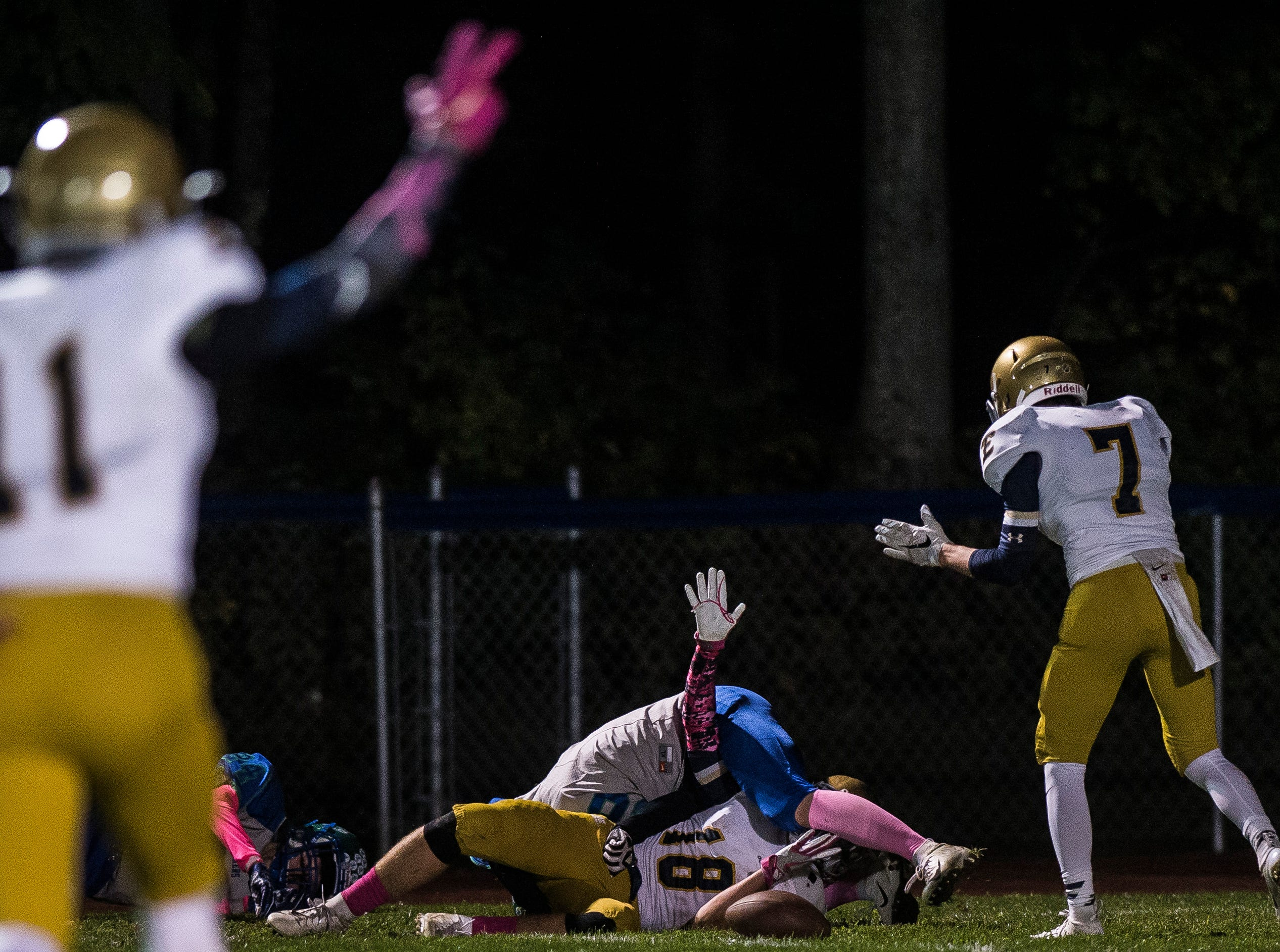 Essex's #18 Luke Williams gives a high five after scoring a touchdown catch during their football game against Colchester on Friday night, Oct. 5, 2018, at Colchester High School. The Lakers won, 28-7.