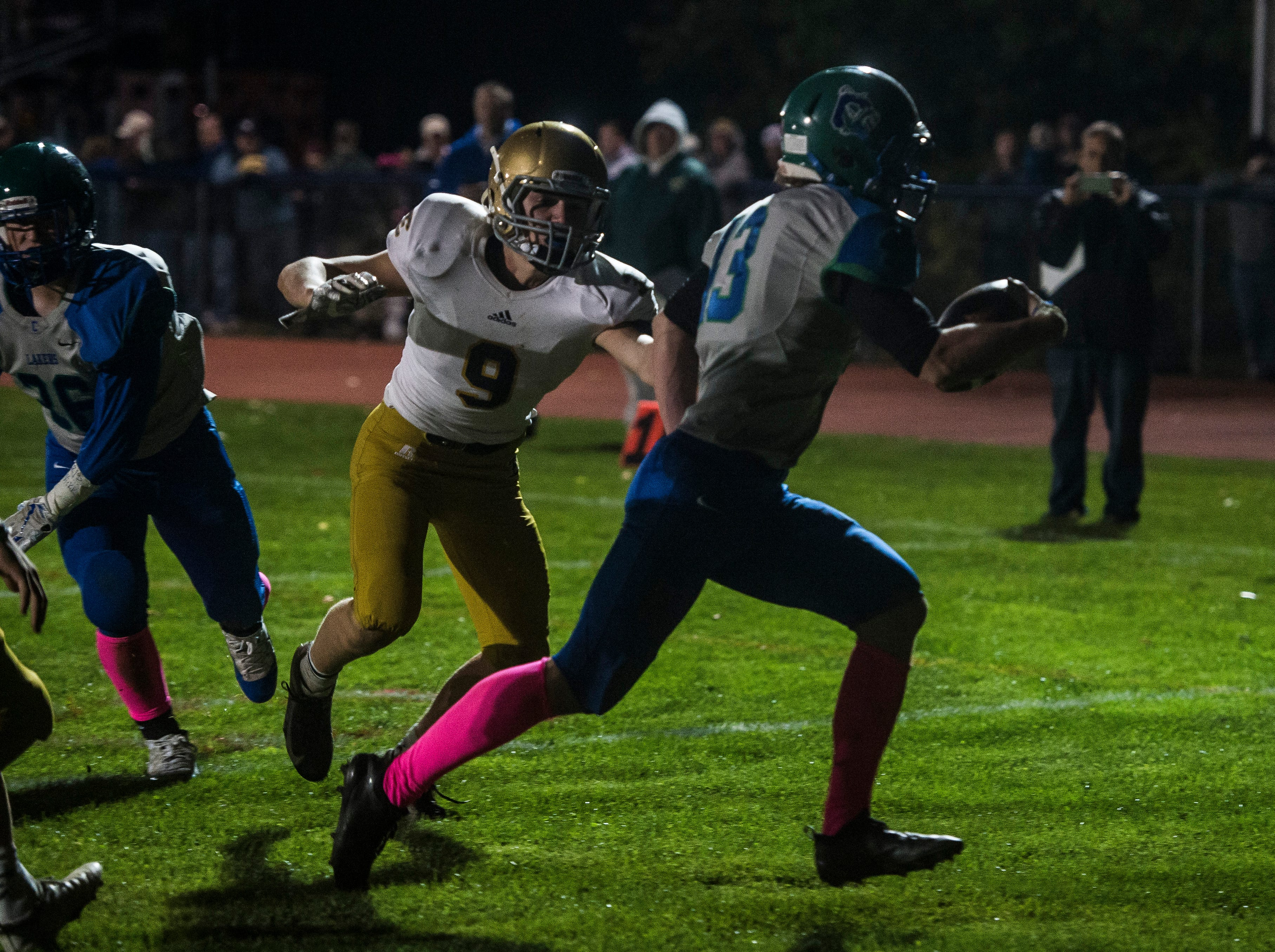 Colchester #43 Max Anderson cruises into the end zone for the touchdown past Essex #9 Chris Davis during their football game Friday night, Oct. 5, 2018, at Colchester High School. The Lakers won, 28-7.