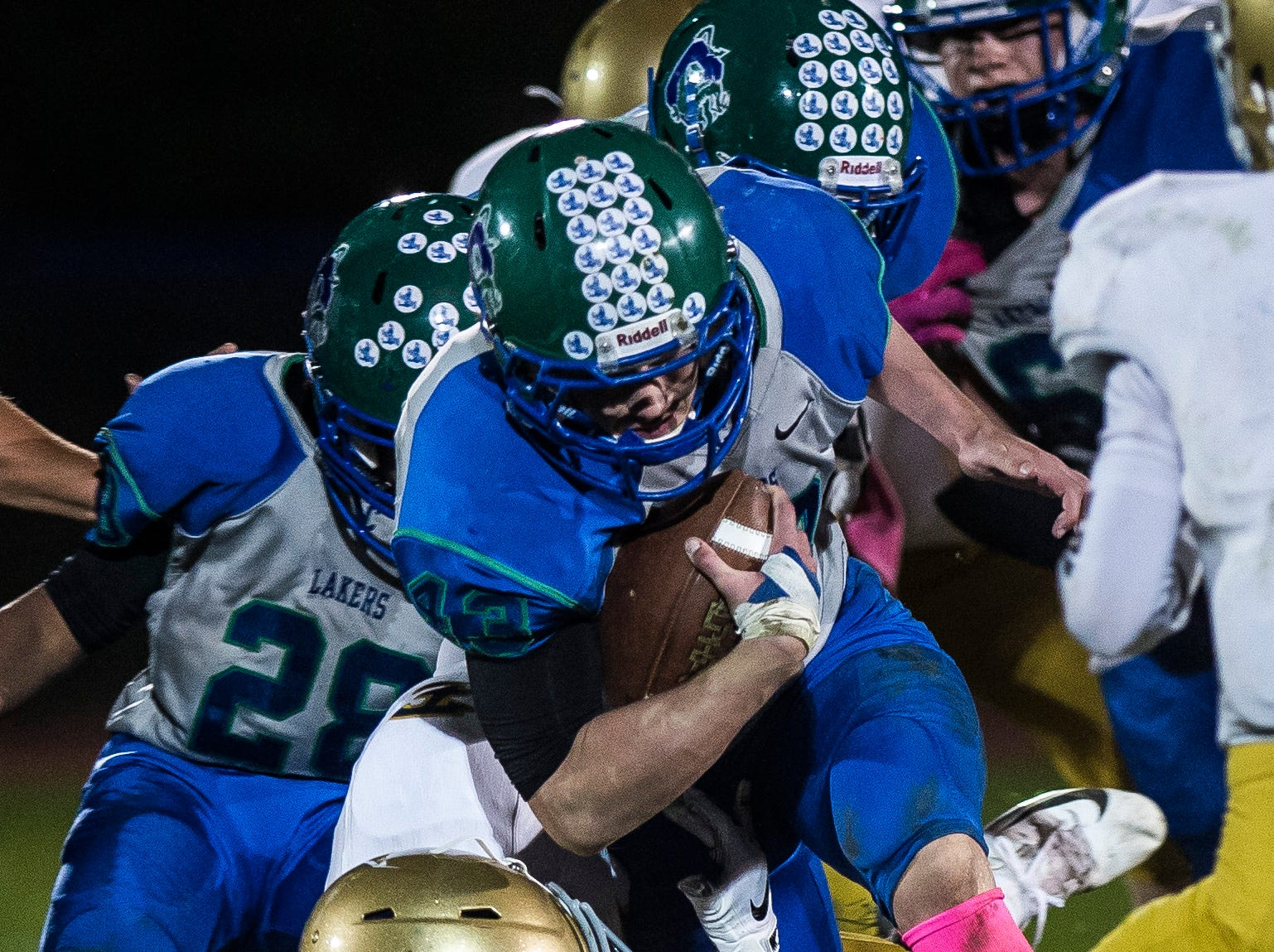 Colchester #43  Max Anderson tries to push through the Essex defense during their football game against Essex Friday night, Oct. 5, 2018, at Colchester High School. The Lakers won, 28-7.