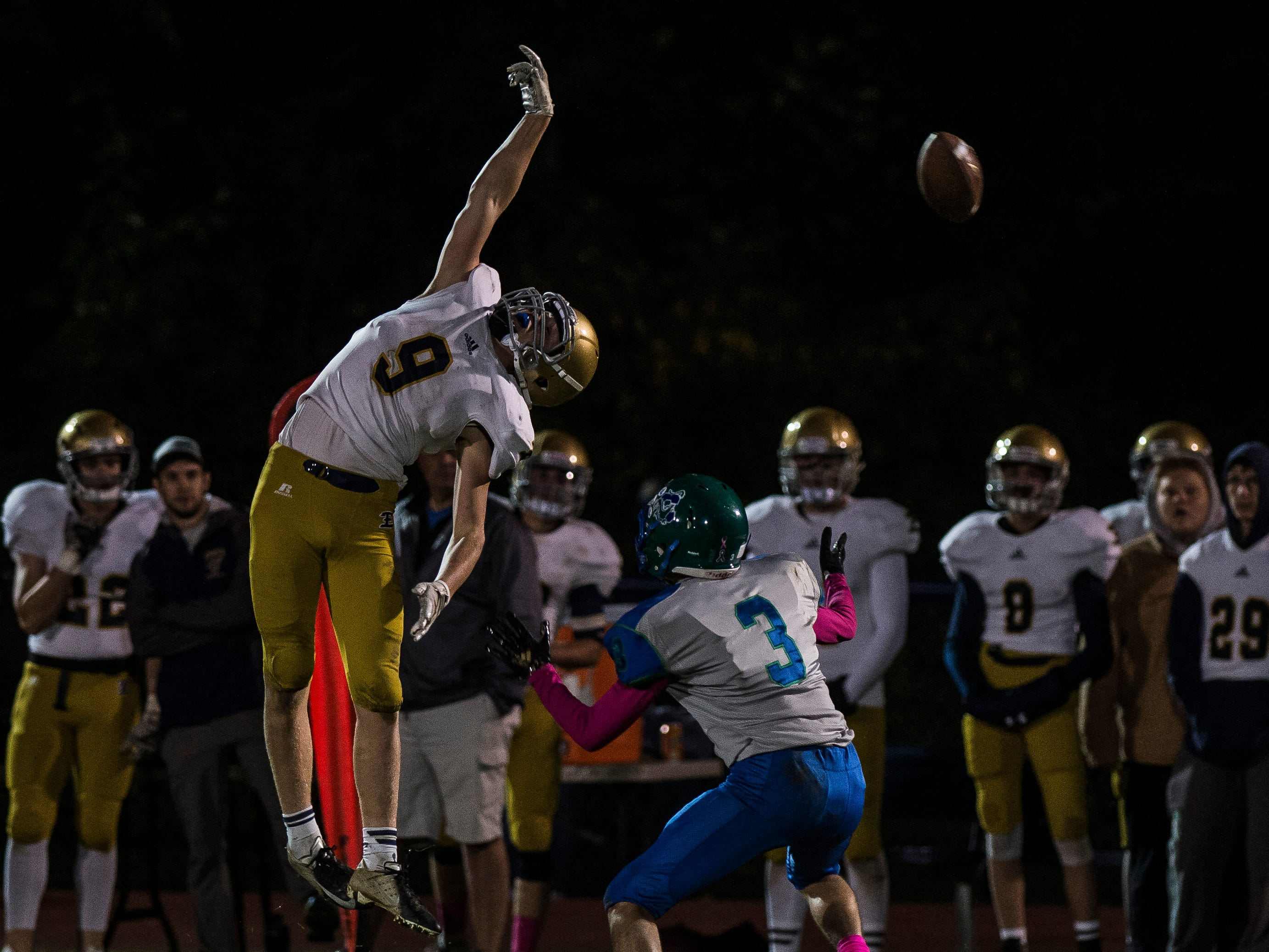 Essex #9 Chris Davis reaches for a high pass during their football game against Colchester Friday night, Oct. 5, 2018, at Colchester High School. The Lakers won, 28-7.
