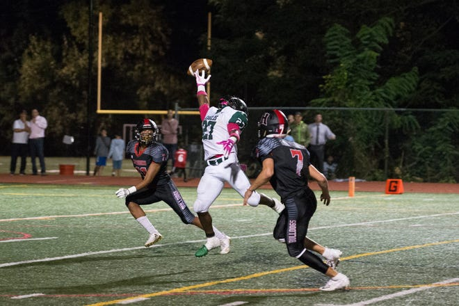 A pass intended for West Deptford's Tyshawn Bookman (27) falls incomplete in a game against Haddonfield Friday, Oct. 5, 2018 in Haddonfield N.J.