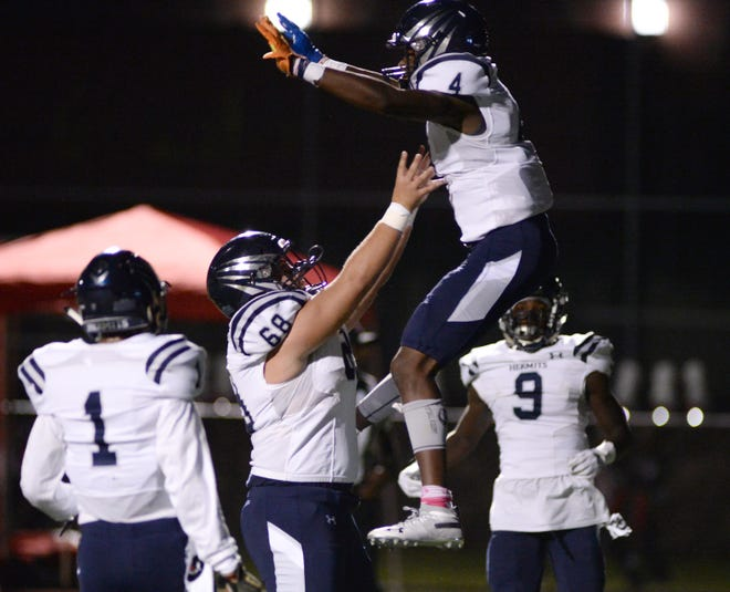 St. Augustine's Justin Mirenda tosses Nasir Hill in the air after the latter scored a touchdown during Friday's win at Rancocas Valley. The fifth-ranked Hermits host No. 6 Holy Spirit on Friday.