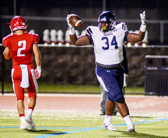 St. Augustine's Isaiah Raikes celebrates after finding the end zone for a Hermits touchdown during Friday night's football game against Rancocas Valley at Rancocas Valley High School,  Oct. 5, 2018.