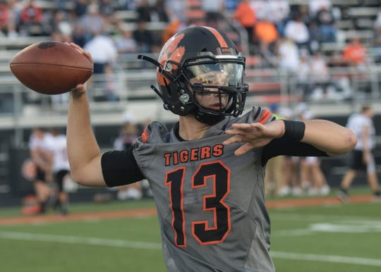 Waverly High School quarterback Haydn' Shanks warms up before a game against Wheelersburg in 2018. Waverly went 9-2 and finished second in the SOC II last year, now they look to go deeper in the playoffs in 2019.