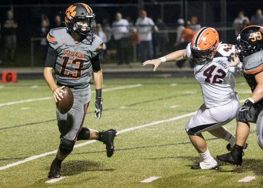 Waverly High School quarterback Haydn' Shanks rolls out of the pocket in a game against Wheelersburg in 2018. Waverly went 9-2 and finished second in the SOC II last year, now they look to go deeper in the playoffs in 2019.