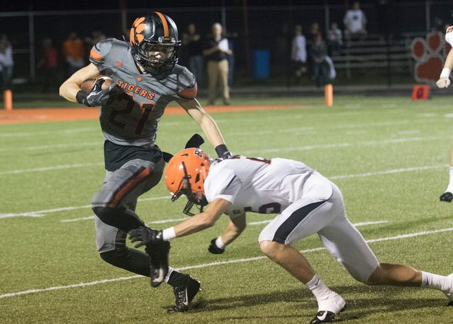 Waverly's Phoenix Wolf tries to avoid a tackle by Wheelersburg's Hunter Ruby Friday night in Waverly, Ohio. Wheelersburg defeated Waverly 49-0.