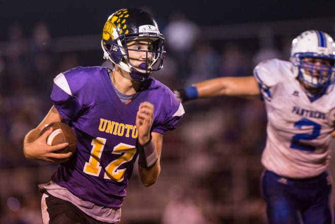 Unioto's Aiden Loeffler (12) runs toward the end zone as the Sherman Tanks take on the Southeastern Panthers at Unioto High School on Friday, Oct. 5, 2018. The Panthers defeated the Tanks 20-13.