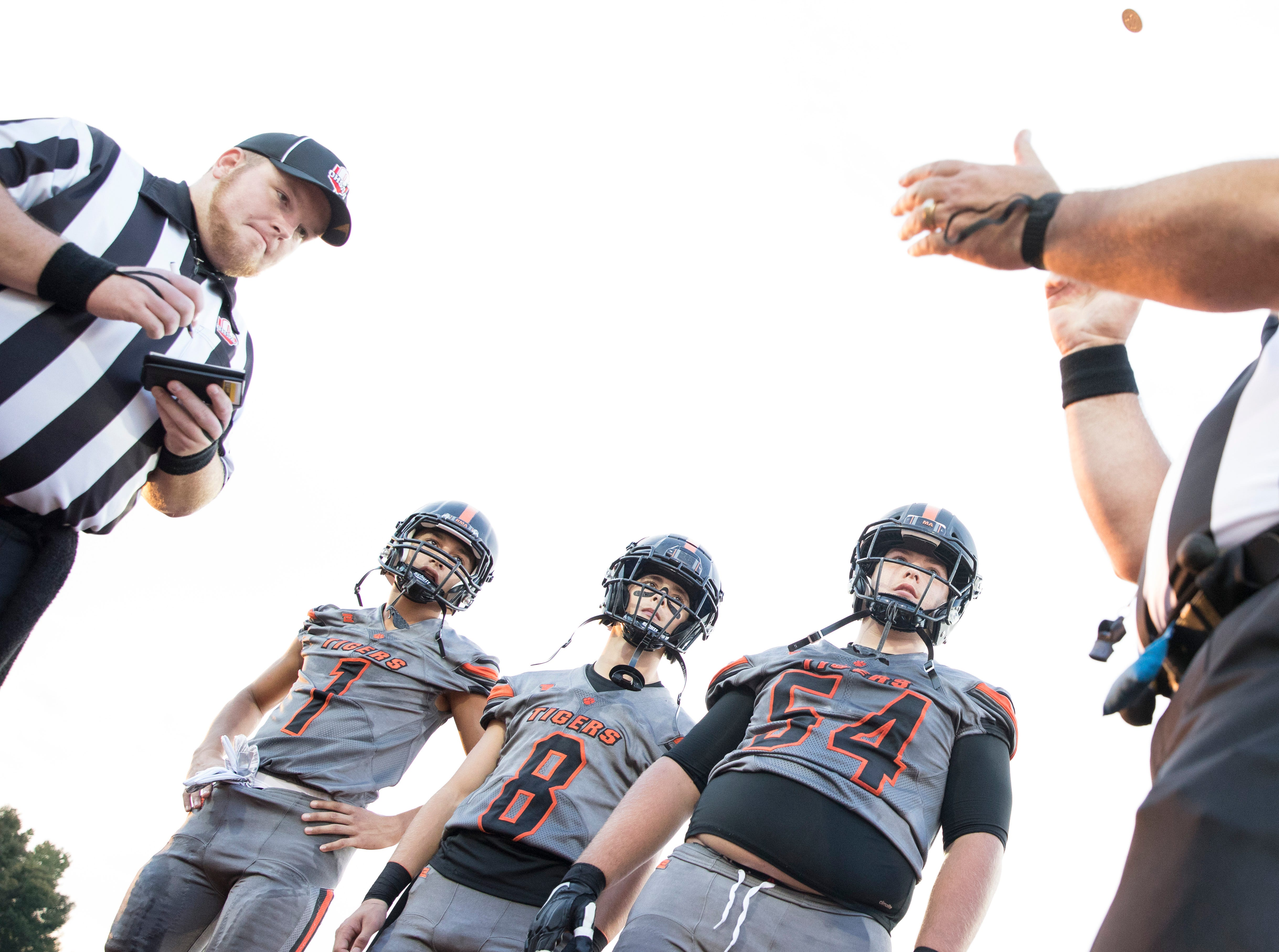 Waverly football seniors, left to right, Cobe Marquez, Ethan Brooker, and Macayne Bock await the results of the coin toss before their game against Wheelersburg on October 5, 2018, in Waverly, Ohio.
