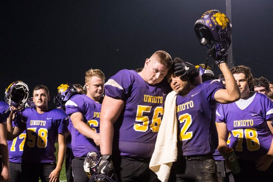 Unioto's Dalton Ford and Chris Scaggs embrace after their loss to Southeastern Friday night 20-13.