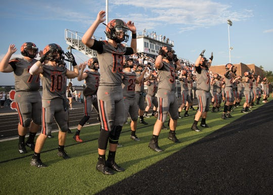 Waverly High School quarterback Haydn' Shanks and his teammates do jumping jacks before a game against Wheelersburg in 2018. Waverly went 9-2 and finished second in the SOC II last year, now they look to go deeper in the playoffs in 2019.