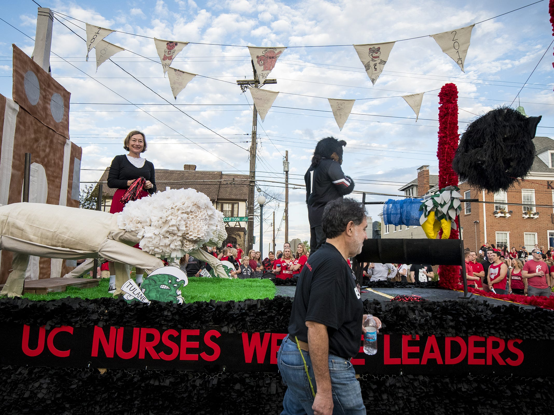 Vintage bearcat logos adorn the UC nursing school's float in the annual University of Cincinnati Homecoming parade.