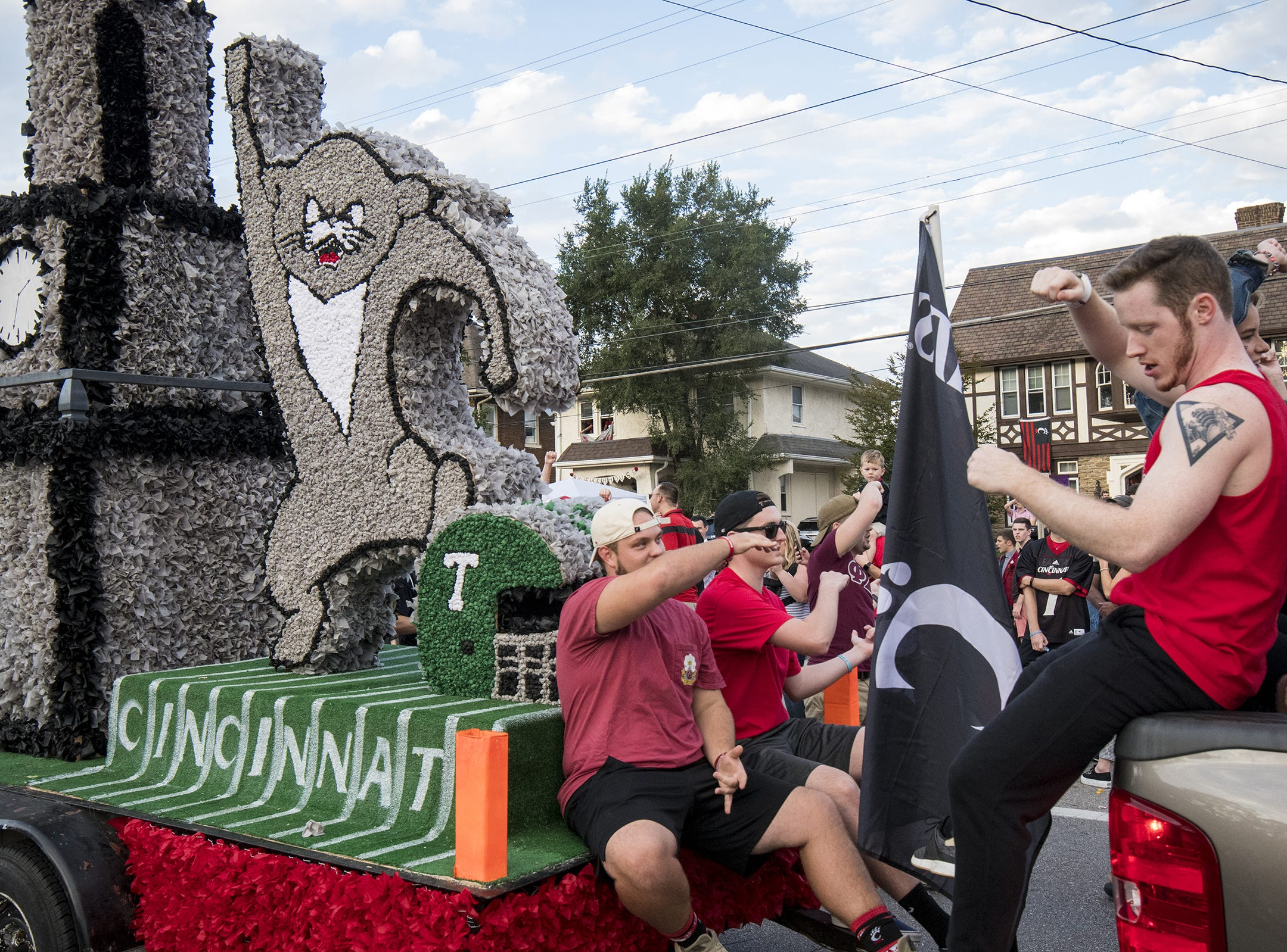 Students lead the crowd in the Down the Drive chant during the annual University of Cincinnati Homecoming parade.