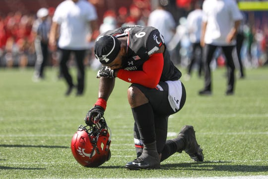 UC's LB Perry Young kneels before the game against the Tulane Green Wave at Nippert Stadium on Saturday Oct. 6, 2018.