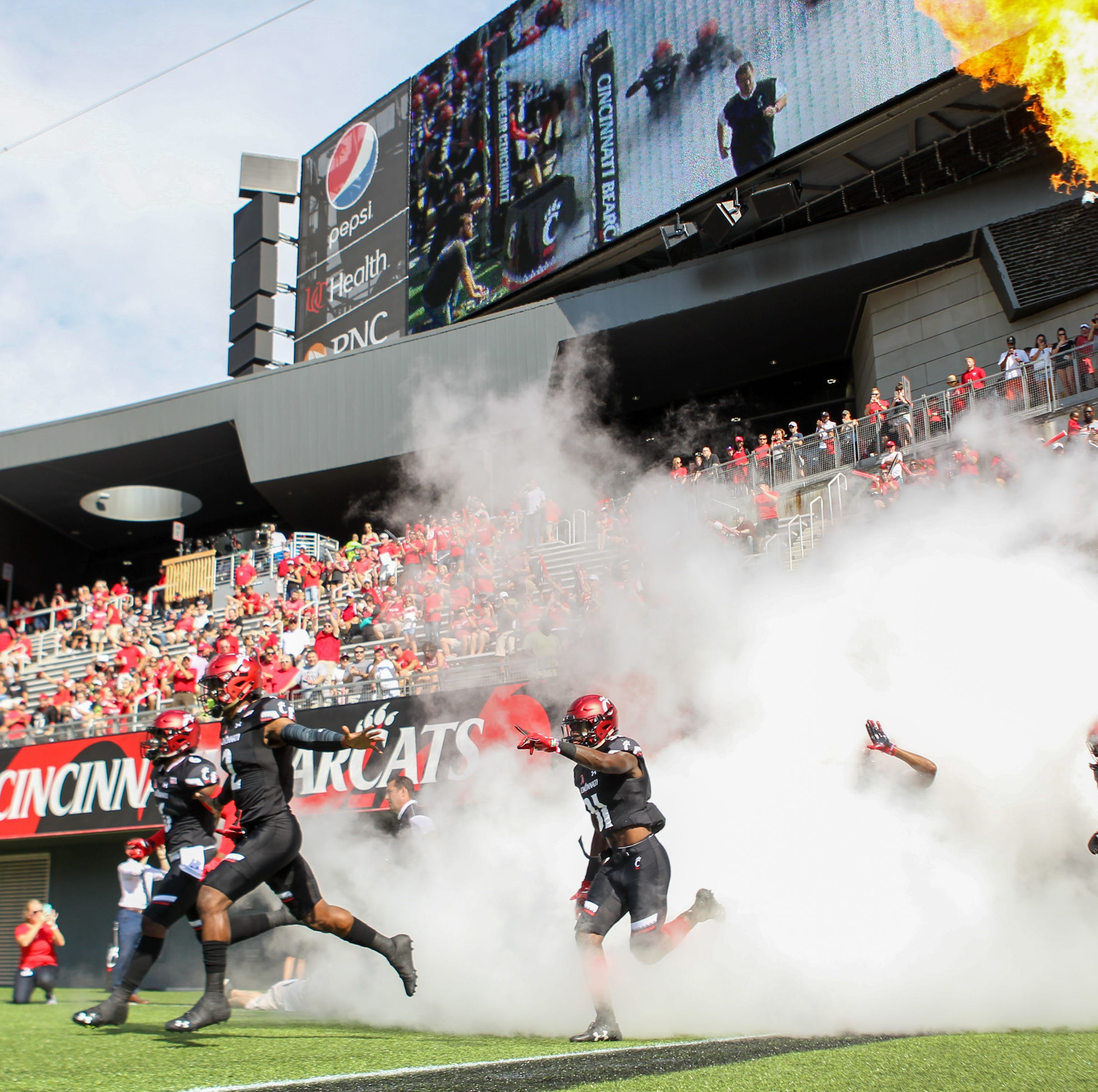 UC Bearcats climb in Top 25 college football polls despite bye