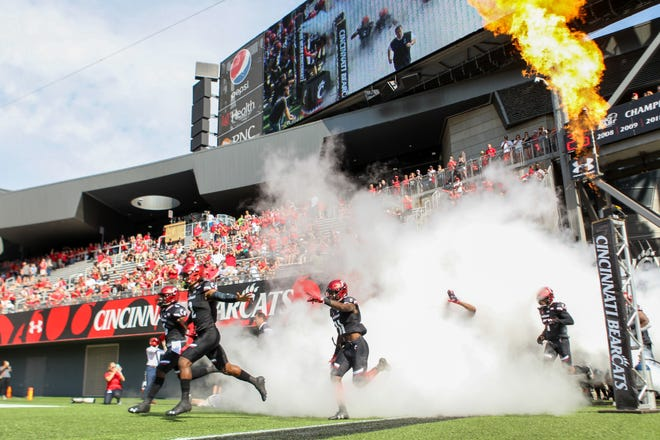 The UC Bearcats get rush onto the field for their game against The Tulane Green Wave at Nippert Stadium on Saturday Oct. 6, 2018.