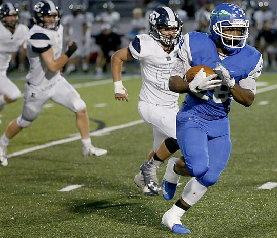 Winton Woods running back Miyan Williams breaks free from the Edgewood defense to run for a touchdown during their game at Fredrick Stadium in Forest Park Friday, Oct. 5, 2018.