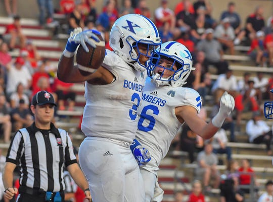 St. X running back Chris Payne (left) and Nathan Stockman (right) celebrate a Bomber touchdown against La Salle at La Salle High School, Green Township, Friday October, 5 2018