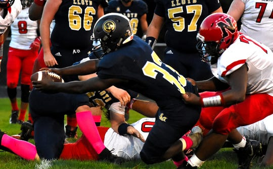 Lloyd Memorial's Travon Mason reaches the rock over the goal line for a Juggernaunts two-point conversion after touchdown, October 5, 2018.