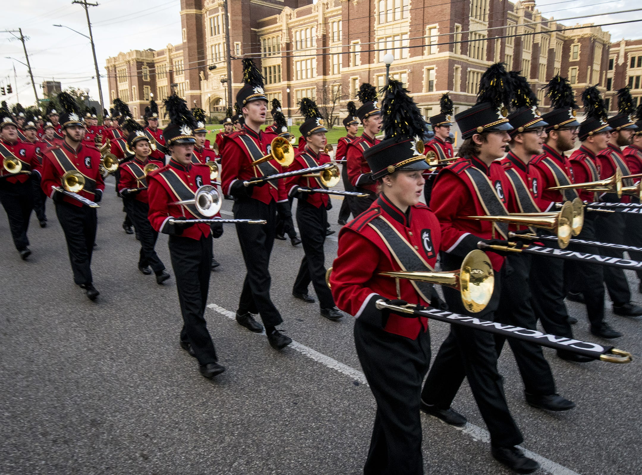 The University of Cincinnati marching band leads the annual Homecoming parade Saturday.