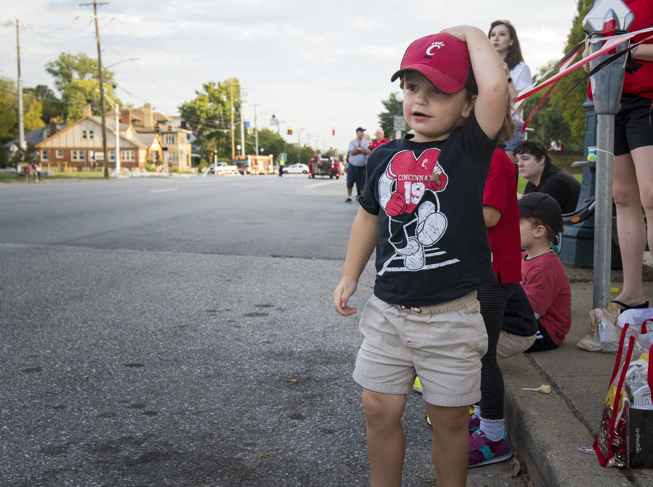 Joe Godshalk, 2, watches the annual University of Cincinnati Homecoming parade.