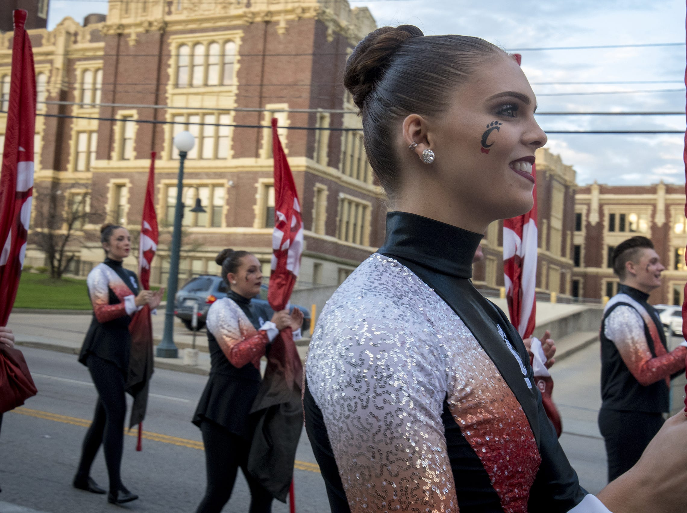 A color guard member marches down Clifton Avenue during the annual University of Cincinnati Homecoming parade.