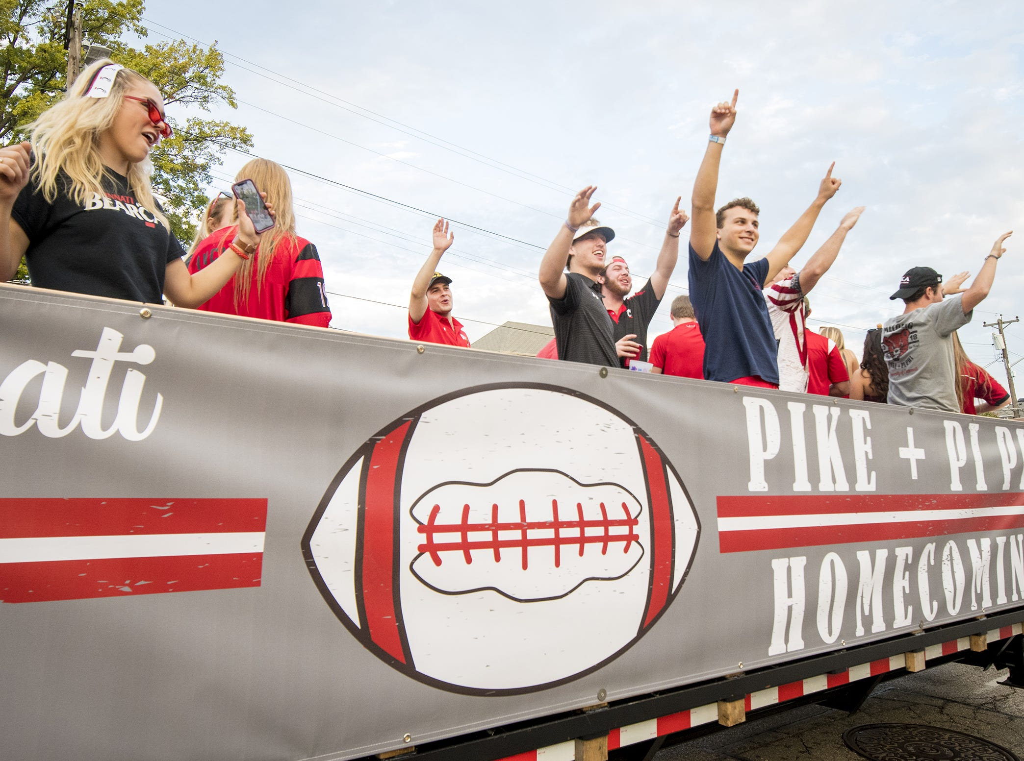 The Pike and Pi Phi float heads down Clifton Avenue during the annual University of Cincinnati Homecoming parade.