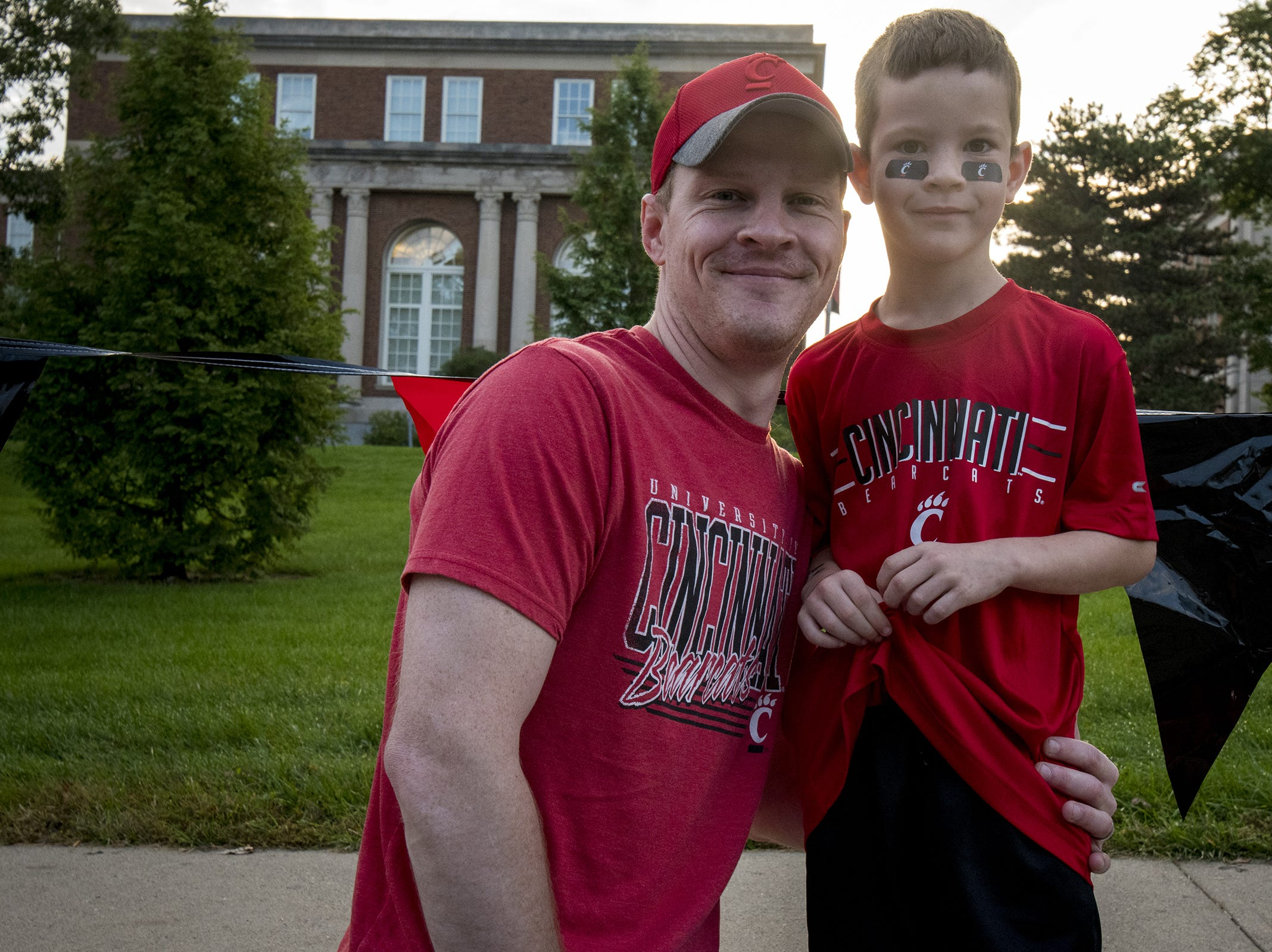 Craig and Everette Bonifas watch the annual University of Cincinnati Homecoming parade.