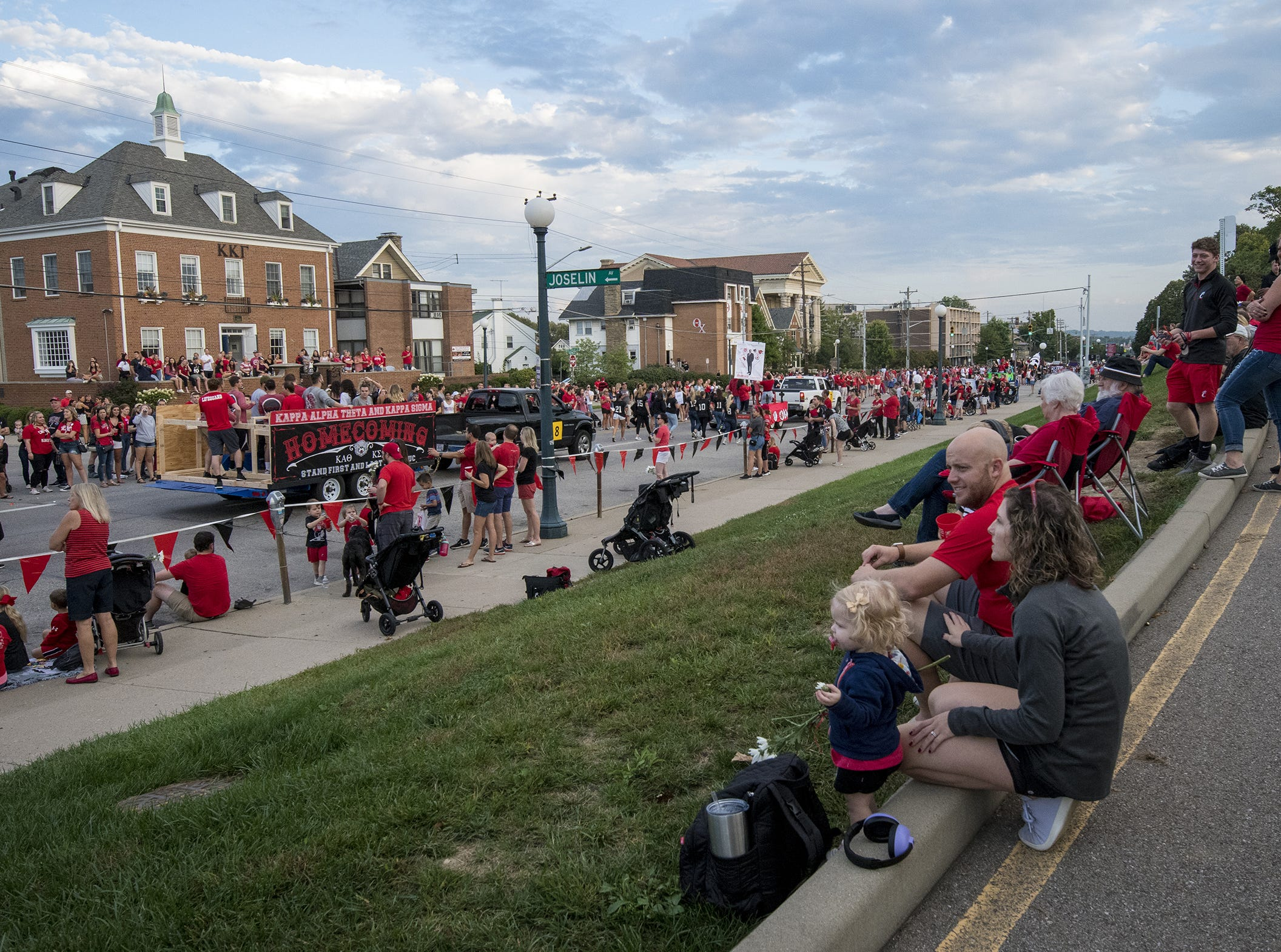 People line Clifton Avenue for the annual University of Cincinnati Homecoming parade.