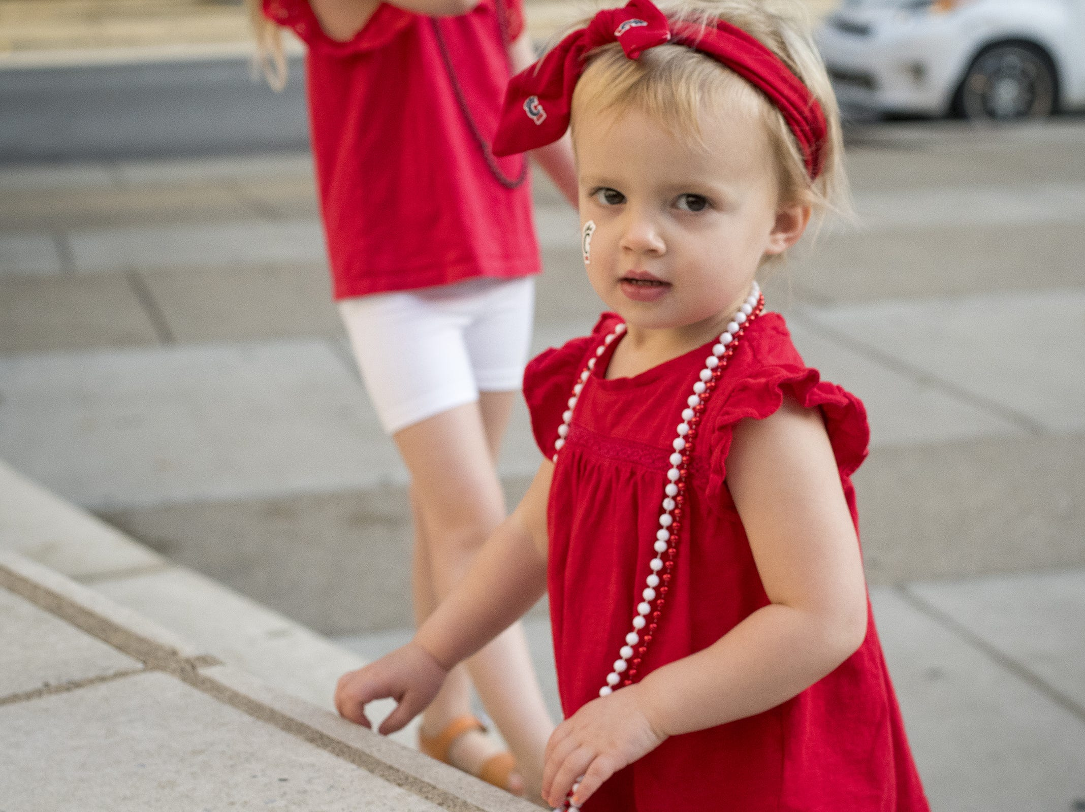 Blair Little, 2, attends the annual University of Cincinnati Homecoming parade.