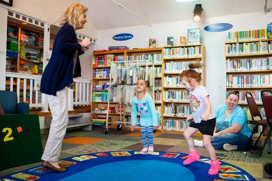Beth Glover (left) leads Iyanna Shelby, 4, and Albi Hoover, 4, (second from right) in exercises during class at The Learning Center Monday, Oct. 1, 2018, in Clarksville, Tenn.