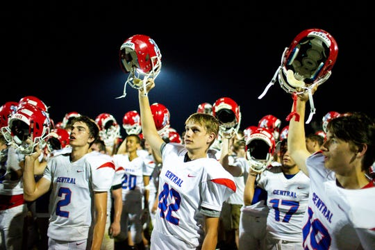 Montgomery Central raises their helmets and sings their anthem after the game at Springfield High School Friday, Oct. 5, 2018, in Springfield, Tenn.