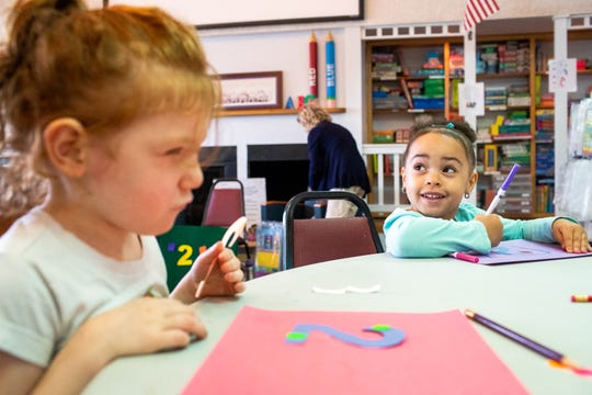Iyanna Shelby, 4, looks up from her drawing as Albi Hoover, 4, (left) begins to focus during class at The Learning Center Monday, Oct. 1, 2018, in Clarksville, Tenn.