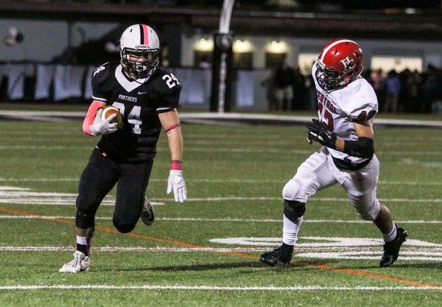 Brett MacMath runs the ball during the first half of a football game at Bridgewater-Raritan High School on October 5, 2018.