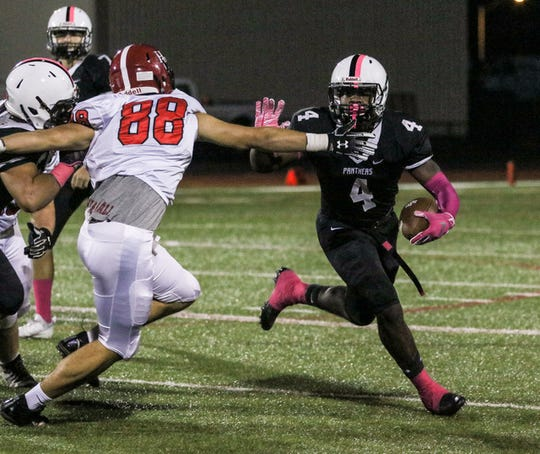 Bridgewater-Raritan's Anthony Goffe runs the ball as Hunterdon Central defends during the first half of a football game at Bridgewater-Raritan High School on October 5, 2018.