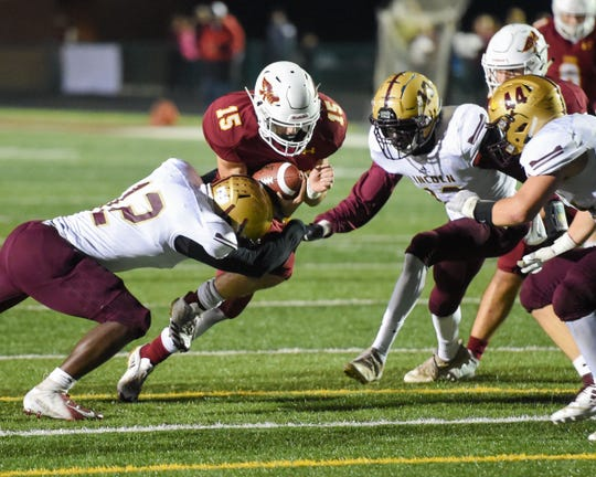 Ankeny's Cael Boyd (15) battles through Lincoln defenders on Friday, Oct. 5, 2018 during a football game between the Ankeny Hawks and the Lincoln Railsplitters at Northview Middle Stadium.
