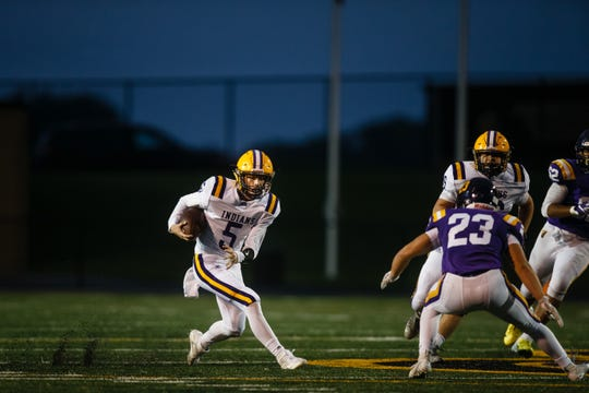 Indianola's Quinn Vesey (5) rushes during their game at Johnston High School on Friday, Oct. 5, 2018 at Dragon Stadium in Johnston.