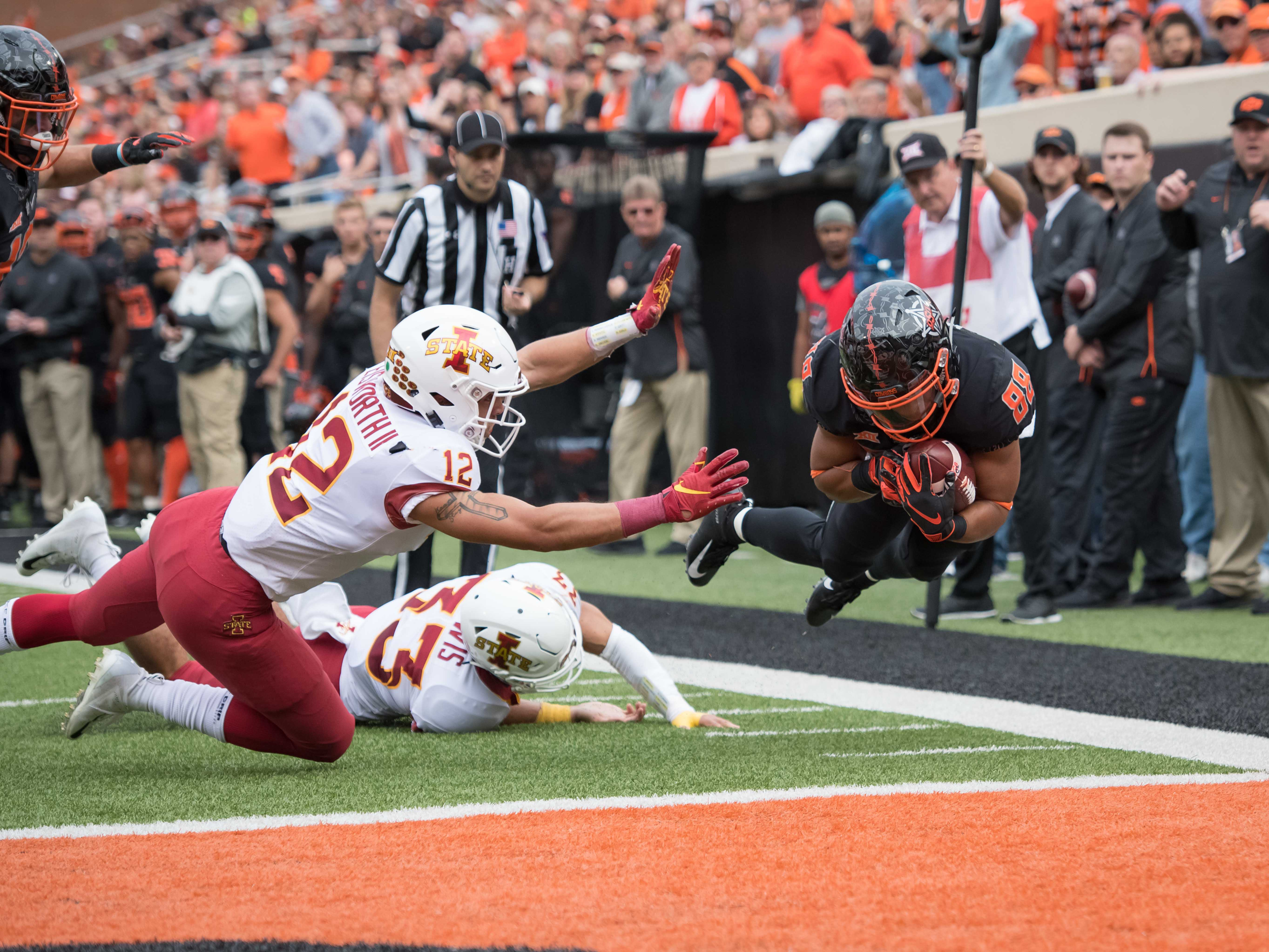 Oct 6, 2018; Stillwater, OK, USA; Oklahoma State Cowboys wide receiver Landon Wolf (88) dives for a touchdown against Iowa State Cyclones defensive back Greg Eisworth (12) and defensive back Braxton Lewis (33) during the first half at Boone Pickens Stadium.